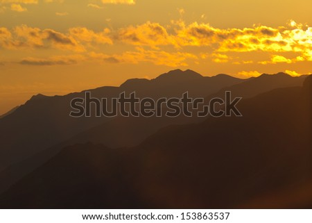 mountain sunrise in the clouds