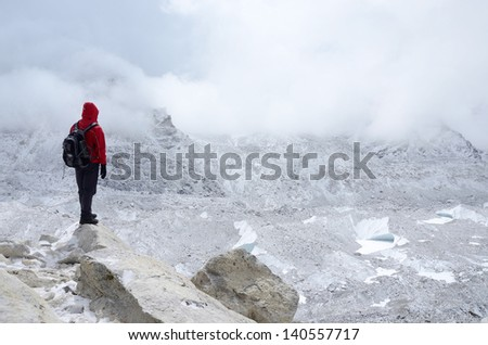 Mountaineer standing near Khumbu Icefall - one of the most dangerous stages of the South Col route to Everest's summit,Nepal