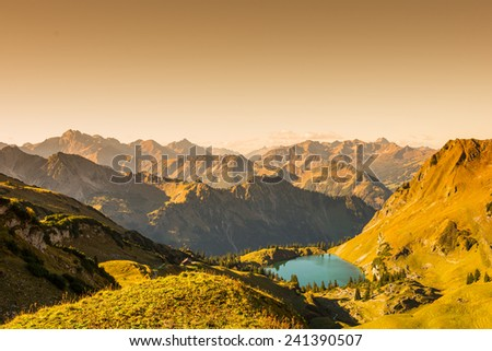 Mountains and lake in the alps with text space