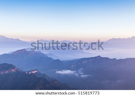 mountains with sea of clouds in Sichuan province looked from the Cattle Hill, China