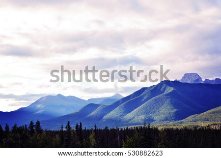 Mountains with trees and clouds