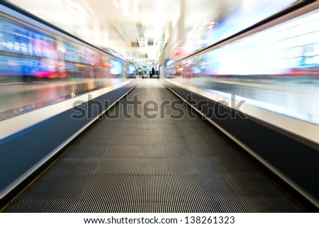 moving escalator of walkway in the airport.