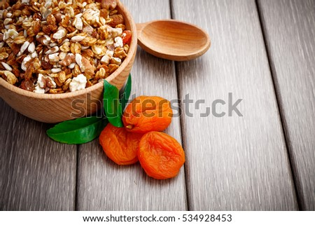 Muesli with nuts and dry fruits on wooden, tasty health breakfast