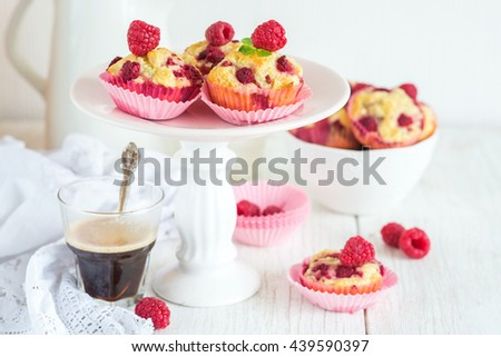 Muffins cupcakes with raspberries and milk, selective focus