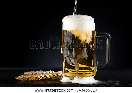 mug beer on a black background