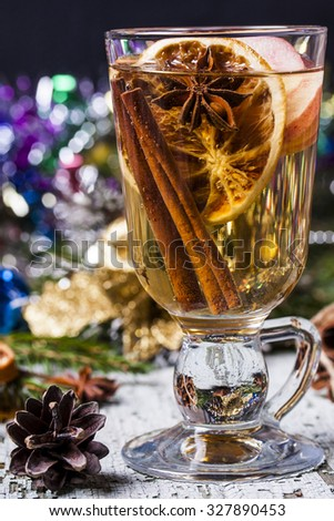 mulled white wine with cinnamon, star anise, apples and oranges