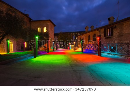 Multi colored lights on the Gubbio square of San Giovanni, Umbria - Italy.
