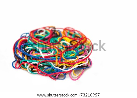 multi-colored needlecraft sewing thread isolated on white