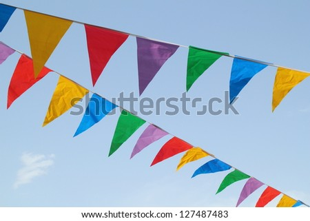 Multi Colored Triangular Flags Hanging in the Sky at an Outdoor Celebration Party.
