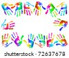 Multi coloured painted handprints in the form of a frame - stock photo