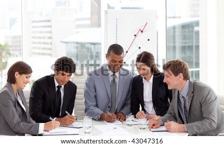 Multi-ethnic business team working together in a meeting