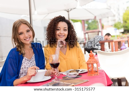 Multi-Ethnic friends talking and having fun at bar's balcony