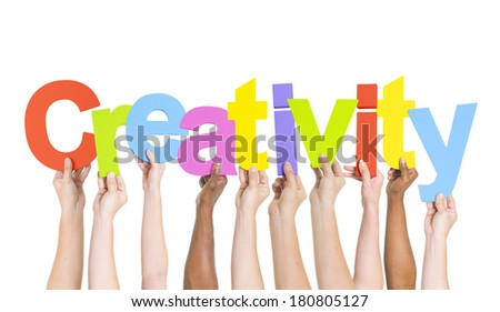 Multi-Ethnic Hands Holding Colorful Letters To Form Creativity