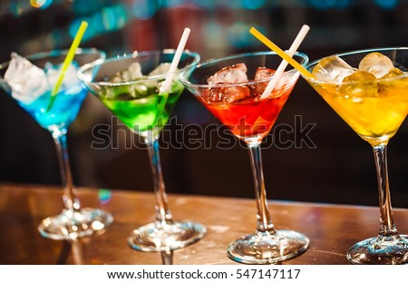 Multicolored cocktails at the bar.