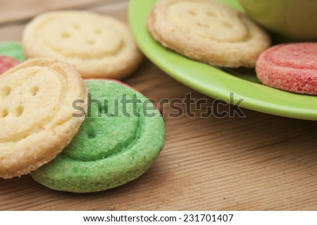 Multicolored sugar cookies on wooden background