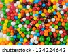 Multicolored Sugar Sprinkles (Edible Cupcake Decorations) Close-Up as Background - stock photo