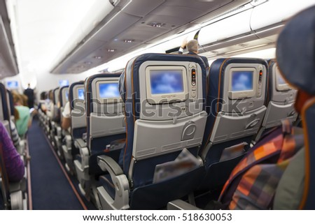 multimedia screens in the seats in the aircraft cabin