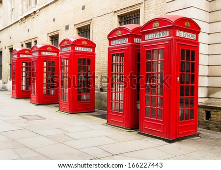 Multiple red telephone boxes in London