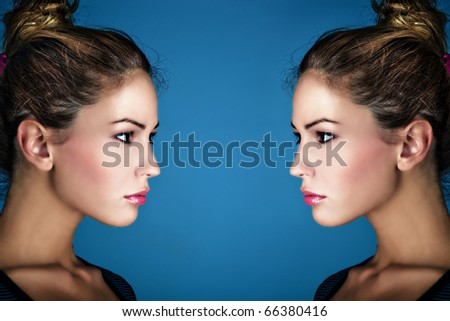 multiplication beauty portrait of young blond woman, profile, studio shot