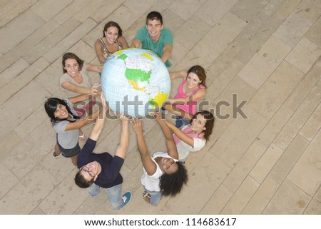 Multiracial group of people holding  the Earth Globe showing America