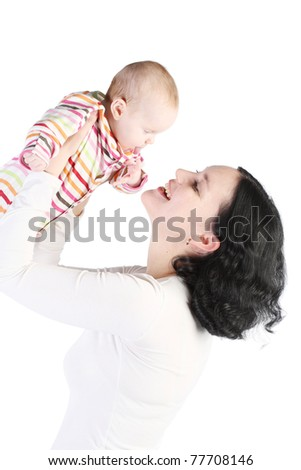Mum holds on hands of the baby. It is isolated on a white background