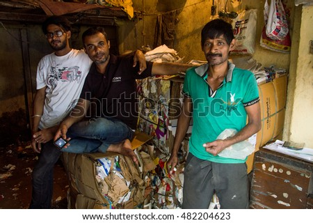 MUMBAI, INDIA - AUGUST 04, 2016: portrait of the guys who work in a recycle factory near dharavi slum in Mumbai, India