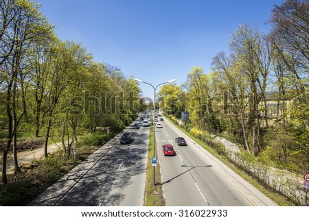 MUNICH, GERMANY - APR 20, 2015: the urban highway divides the english garden in two parts in Munich, Germany. A tunnel is under political discussion to reunify the garden.