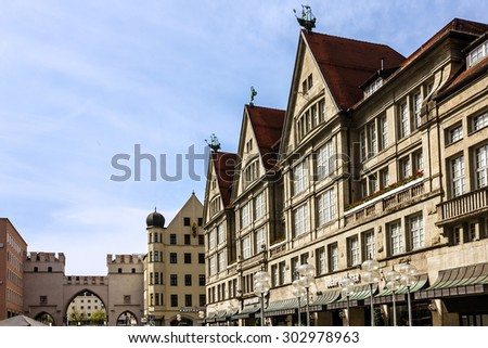 Munich, Germany. Old town gate and buildings