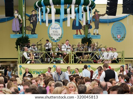 MUNICH, GERMANY - SEPT. 19, 2015:  Oktoberfest Visitors Enjoy Traditional Music and Beer in the Spatenbrau Tent. The Festival runs from September 19th until October 4th 2015 in Munich, Germany.