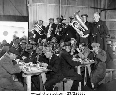 Municipal Lodging House Thanksgiving dinner The hungry and destitute of New York City eat their free thanksgiving dinner accompanied by a brass band Nov.