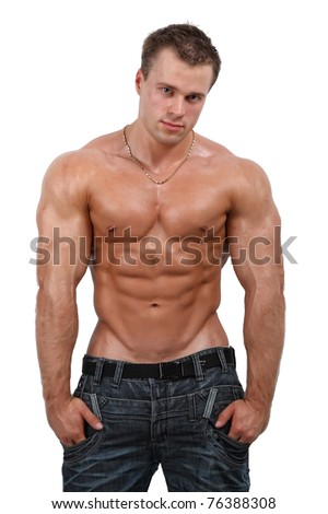 Muscle sexy wet naked young man posing in jeans