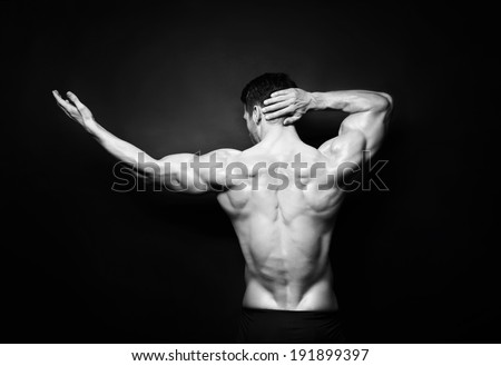 muscular male back in black and white