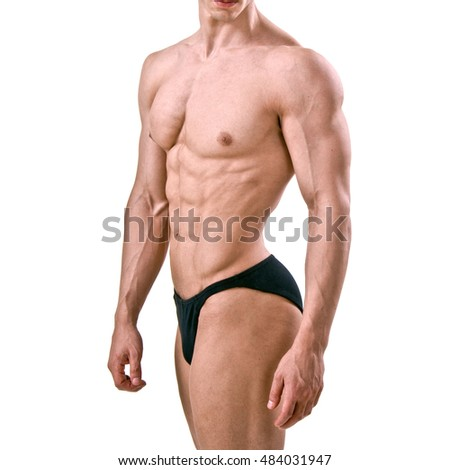 Muscular man bodybuilder. Man posing on a white  background, shows his muscles.