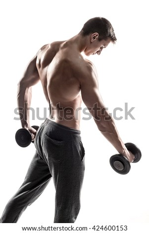 Muscular man doing exercises with dumbbells isolated on white background