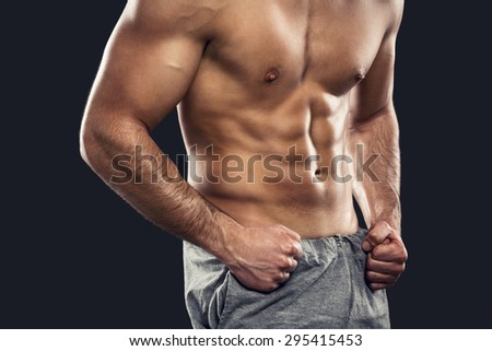 Muscular man, isolated over a gray background