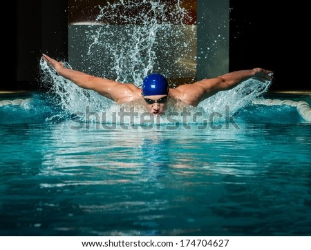 muscular young man blue cap swimming stock photo 175095887 shutterstock. Black Bedroom Furniture Sets. Home Design Ideas