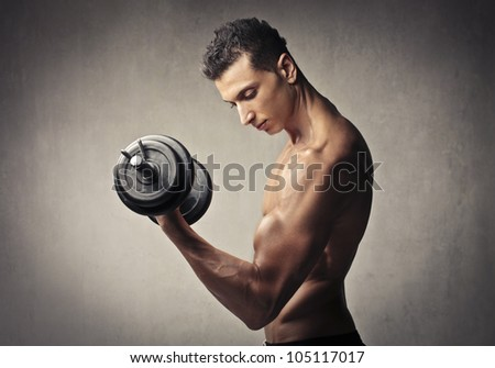 Muscular young man lifting weights