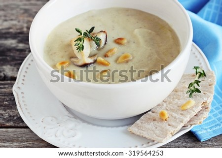 Mushroom and potato cream soup with mushroom topping. Selective focus.