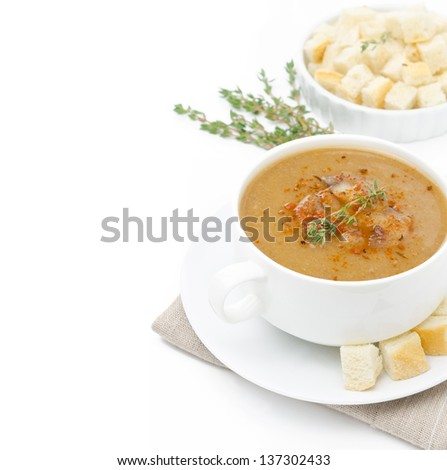 Mushroom cream soup with croutons and thyme isolated on a white background and space for text