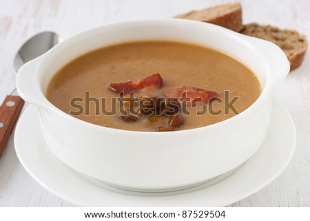 mushroom soup with sausages with bread