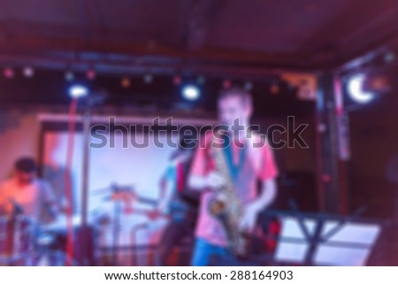 Musical band performing live blur background with abstract bokeh