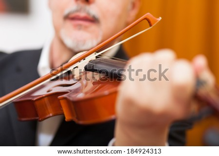 Musician playing his violin