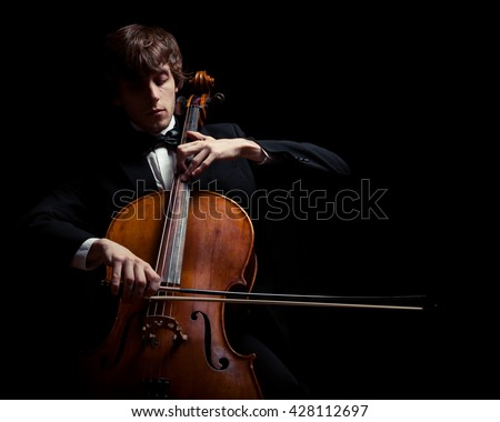 musician playing the cello. Black background