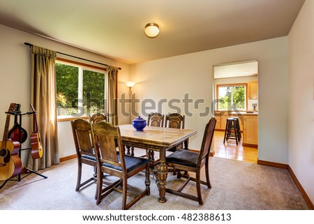 Musician's dining room with carved table set and guitars. Northwest, USA