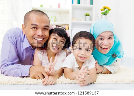 muslim family lying on the floor
