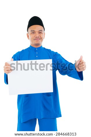 Muslim man holding a white board and raised his thumb up