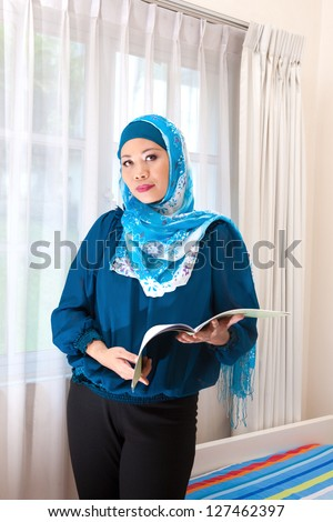 Muslim woman using a tablet computer