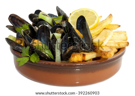 Mussels with herbs and chips isolated over white