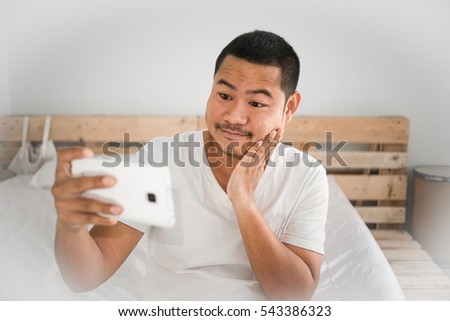 Mustache Man faces squares Playing Mobile Smart Phone Showing expression and emotion  such as Think, Angry,edgy,shock,be smile,love,wow, glad,cheer,Press the button .