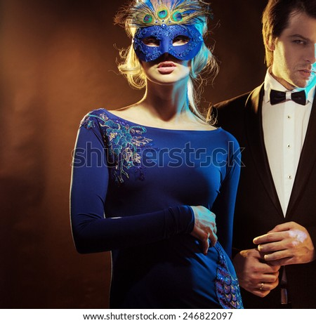 Mysterious carnival mask couple
